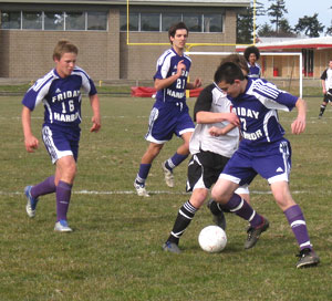 Defender Mathew Skeels stops another offensive thrust by Coupeville.
