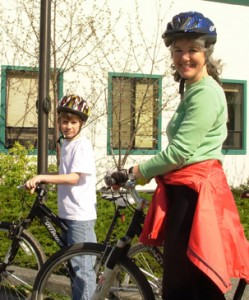 Pamela Williams biking with Ian.