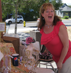 Brenna Woods has a great time, selling her jewelry...