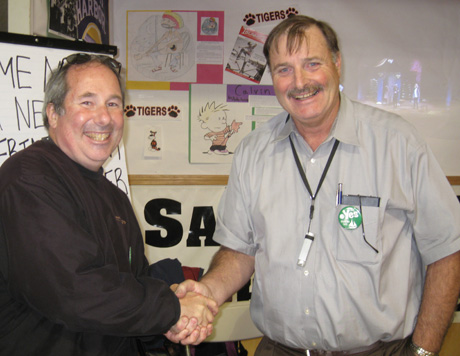 New superintendent Walt Wegener (right, shaking hands with me) was staffing the School District's booth at the Fair...