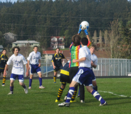 FHHS keeper Ben rises above the crowd to take the ball away from the Spartans on a corner kick.