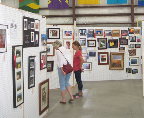 Fairgoers enjoy the photo exhibit at the 2012 fair -  Kevin Holmes photo