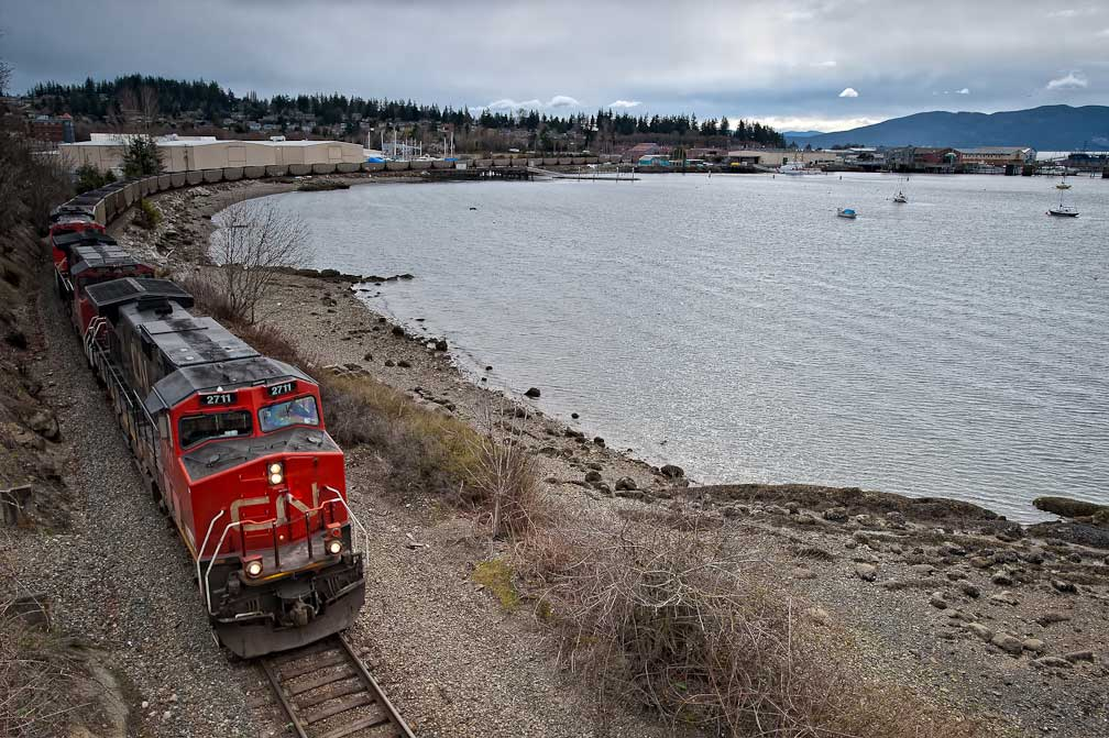 A train carrying coal passes through Bellingham's Fairhaven district on its way to the Westshore coal terminal in BC. With a proposed new coal terminal in Bellingham, train shipments through Washington State are set to increase dramatically. (Photo by Paul K. Anderson) And thanks to coaltrainfacts.org and seattleglobalist.com for the information.