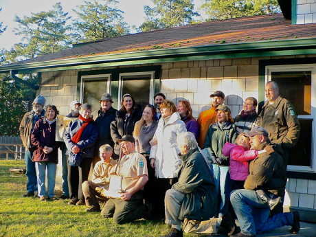 State Park volunteers and others at a farewell party last year for Billy Hoppe, who had been assistant ranger here for 17 years. When his job was cut to part-time he reluctantly left for Camano Island State Park. Back row, left to right: Ed and Clare Kelm, Dennis Linden, Eileen and Dan Drath, Diane Gardetto, Doug McCutchen, Kari Koski, Eric Eisenhardt, Jenny Atkinson, Ranger Ted Schlund. Middle row: Erin Corra, founder of FOLKS, Andrea Wieland, Shirley Zyph. Kneeling: Allan Smith, Billy Hoppe, John Dustrude, and Ken Schilling holding Kensey - Louise Dustrude photo