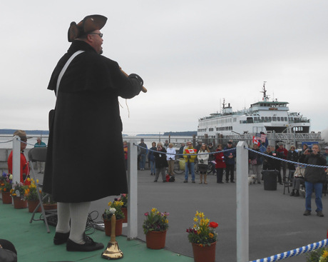 Anacortes town crier Richard Riddell thanks the Sidney crowd for their hospitality, at Sunday's celebration in Sidney, BC of the opening of the international run for Washington State Ferries.