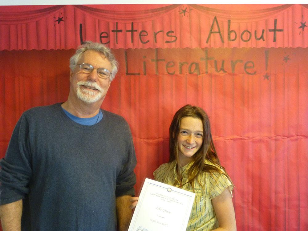 Parent volunteer John Davis with Ula Grace. Not pictured: Eden Light