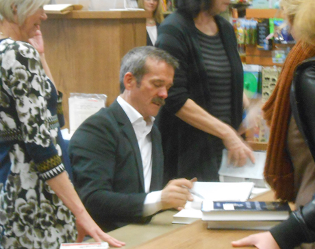 Canadian space hero & rock star Chris Hadfield came by the other day to sign his new book for over 1500 folks at a local bookstore, so we dropped by to wave at him. Woman next to me fainted - thought she was waving at her, but he was saying hey to me. I just know it. Photo by paparazzi photographer Ian Byington.