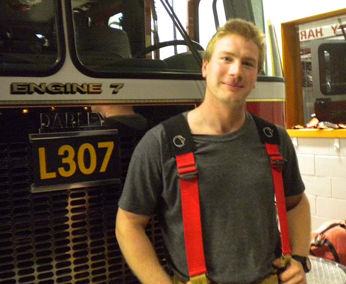 Brandon Baney pictured here in front of his favorite fire truck, Ladder 317 - Sheila Harley photo