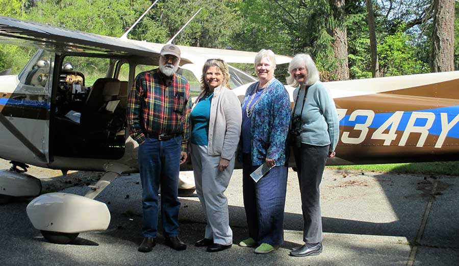 Pictured are Ed Kelm, pilot, Kim Abel LWVWA President, Pat Dickason, Vice-President and Lobby Team Chair, and Raelene Gold, League Natural Resources Lobbyist - Click for larger version - Contributed photo