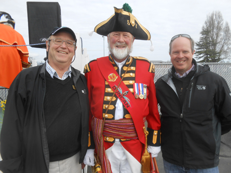 San Juan County council members Bob Jarman (left) and Rick Hughes join the town crier from Duncan, BC to celebrate the first ferry run of the spring from the mainland US and San Juan Island to Vancouver Island.