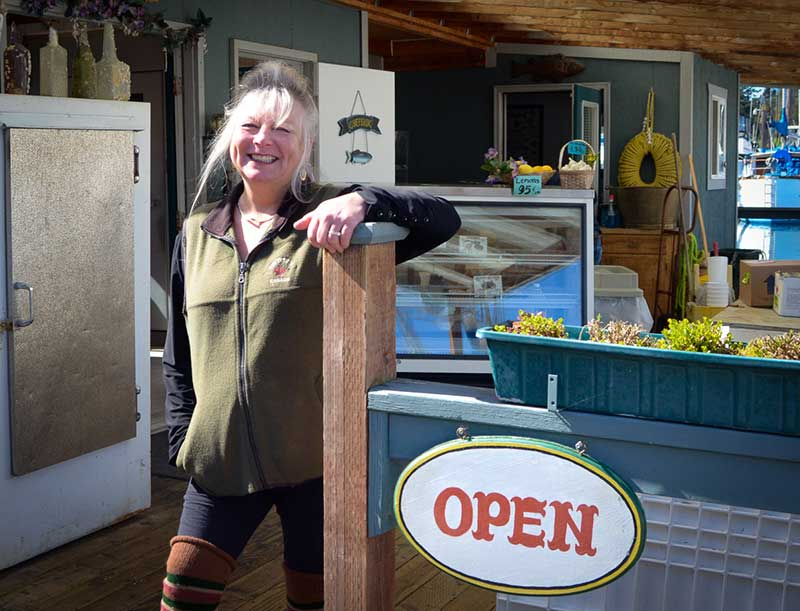 Brenda is happy to be open again down on the floating fish store (Eric was  unavailable for the photo, as he was busy working on a last minute project on their opening day)