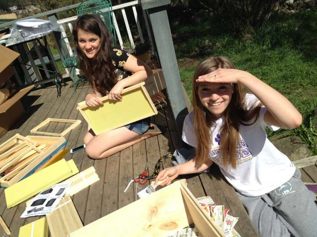 Hailey Loucks (L) and Isabel Gabriel building beehives - Cyndi Brast photo