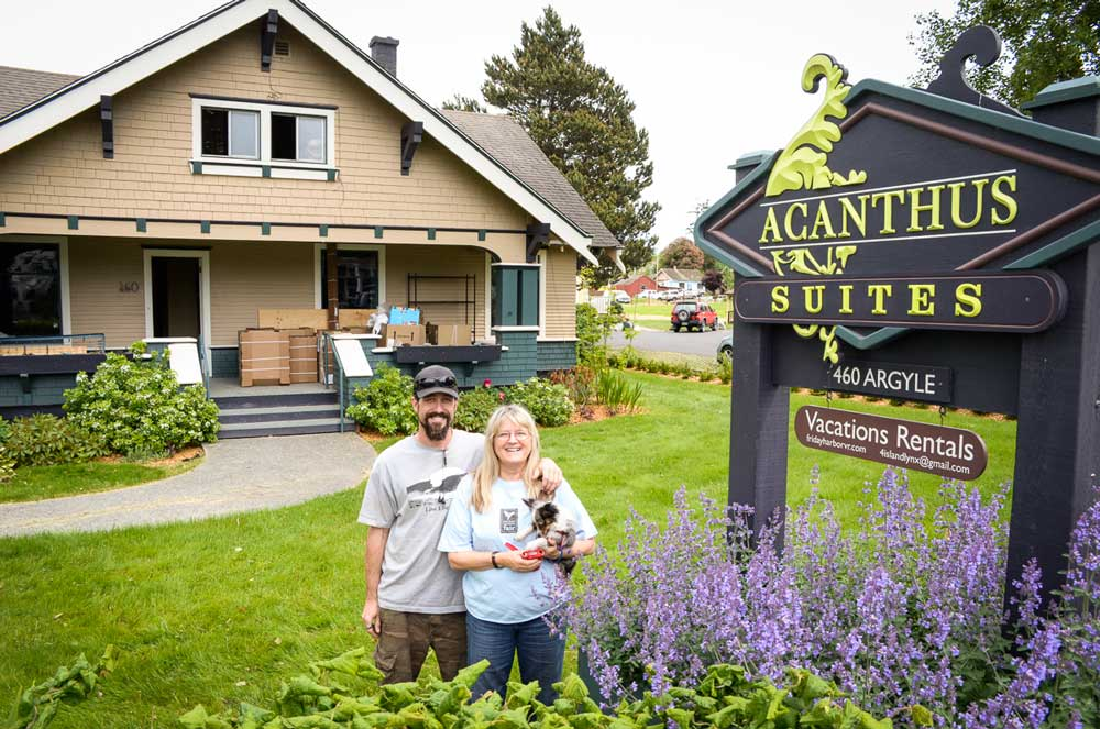 Ryan Bennett, Lynn Danaher and [[dog]], co-owners of Acanthus Suites - Tim Dustrude photo