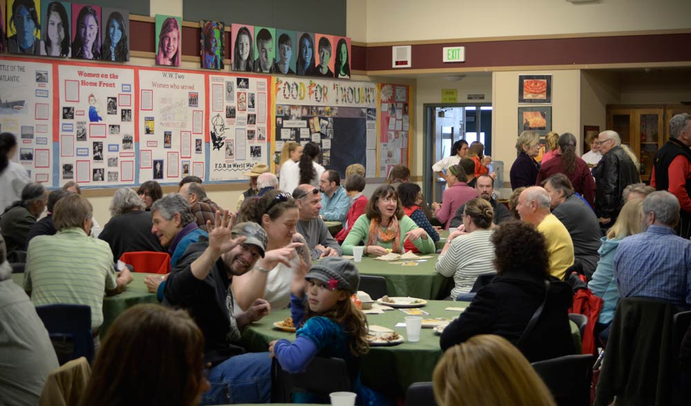 Enjoying last month's Community Dinner at the HS Commons - Click for larger view - SJ Update photo