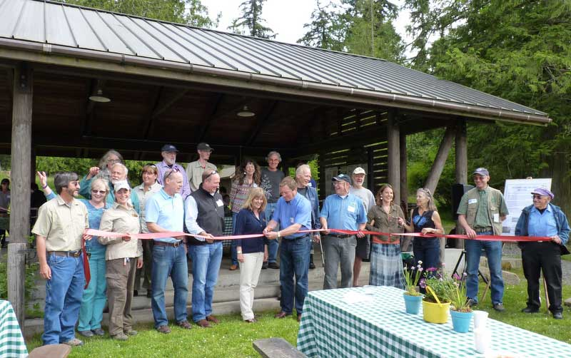 """Dignitaries and current and past County officials join Council Member Jamie Stephens and Parks Director Dona Wuthnow in cutting the ceremonial ribbon at the """"Rediscover Odlin"""" Celebration - Click to enlarge - SJCounty Staff photo"""