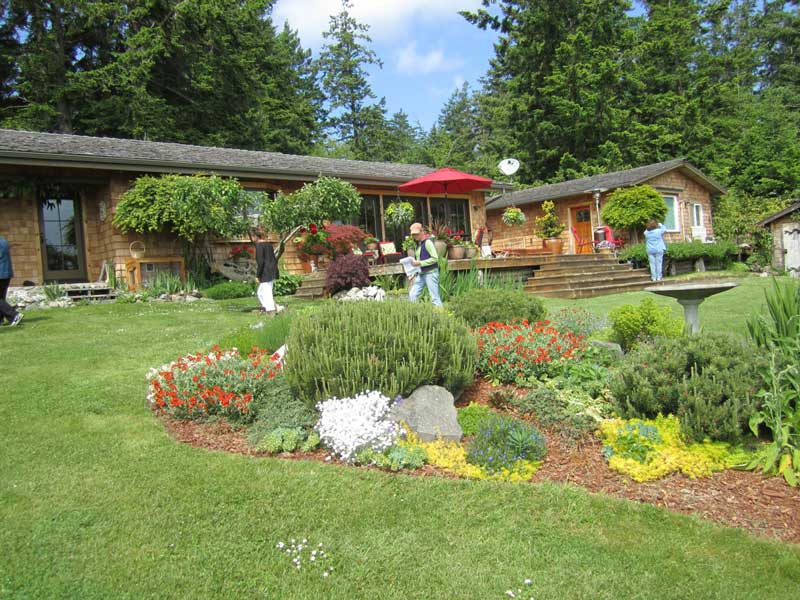 Announcing the 2014 Garden Tour,  Saturday June 14. Pictured here is the Pearson Garden last year - Click to enlarge - Tori Benz Hillstrom photo