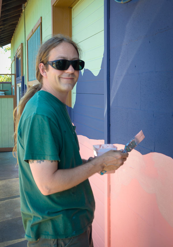 R. Von Plowman, working the mural at FH Pet Supplies - SJ Update photo