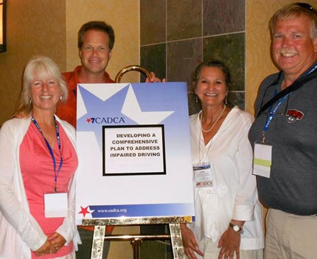 In 2013, Debbi Fincher, Brad Fincher, Cynthia Stark-Wickman and Sheriff Rob Nou represented the San Juan Island Prevention Coalition at CADCA's Mid Year Training Conference - Contributed photo