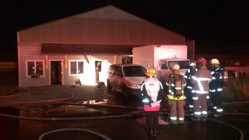 Early morning fire erupts at Sunshine Laundry on Web Street in Friday Harbor - Click to enlarge - Contributed photo