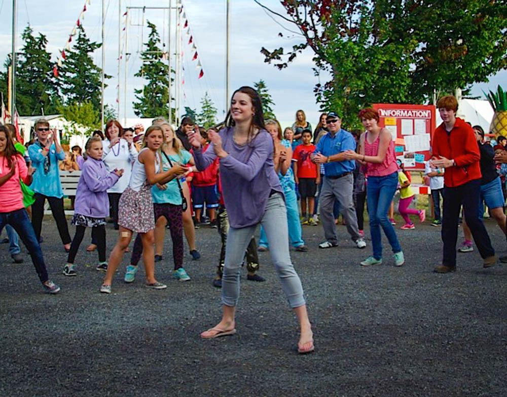 Julie Hagn leads the Happy Flashmob - Debbi Fincher photo