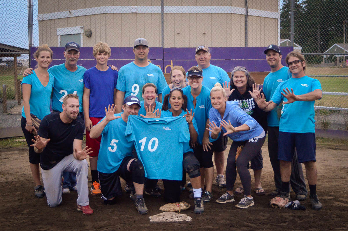 The 10 Year Champions - L to R, Back row: Annie Bryant, Gene Wilson-Captain, Rio Black (bat boy), Frank Finch, Kerri Goff, Liz Chalfant, Mike Goff-Captain, Justin Nibler and Bob Nelson. Front row: John Cornell, Gabe Herda, Molly Finch, Nicki Black and Amber Kleine - Tim Dustrude photo