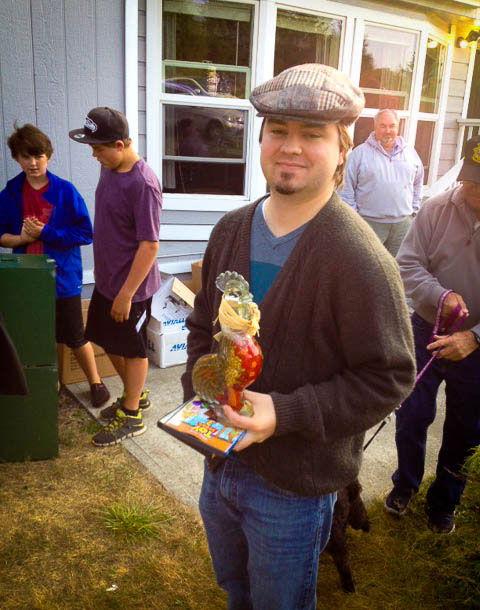 Josh Boland, (you may know him from Whidbey Island Bank) scored this cool Glass Rooster for his wife Micah at the Rummage Sale last Saturday - Jan Murphy photo