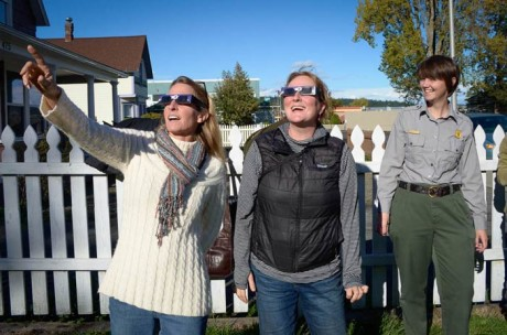 Gretchen Alison and Kari Koski enjoy the partial eclipse with the latest in fashionable eyewear while Raena Parsons looks on - Tim Dustrude photo