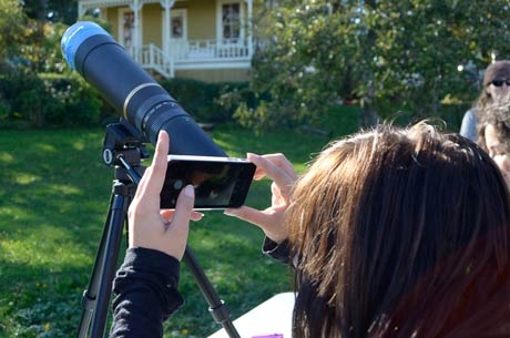 Emmie from the high school shoots a photo of the eclipse with her iPhone through the telescope - Tim Dustrude photos