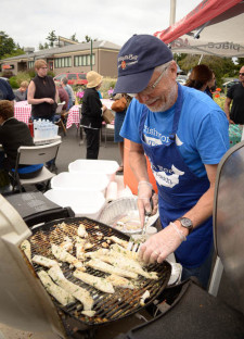 Kerwin Johnson cooks up some delicious Cod at last May's Fish Taco event at the Ace Hardware parking lot - Tim Dustrude photo