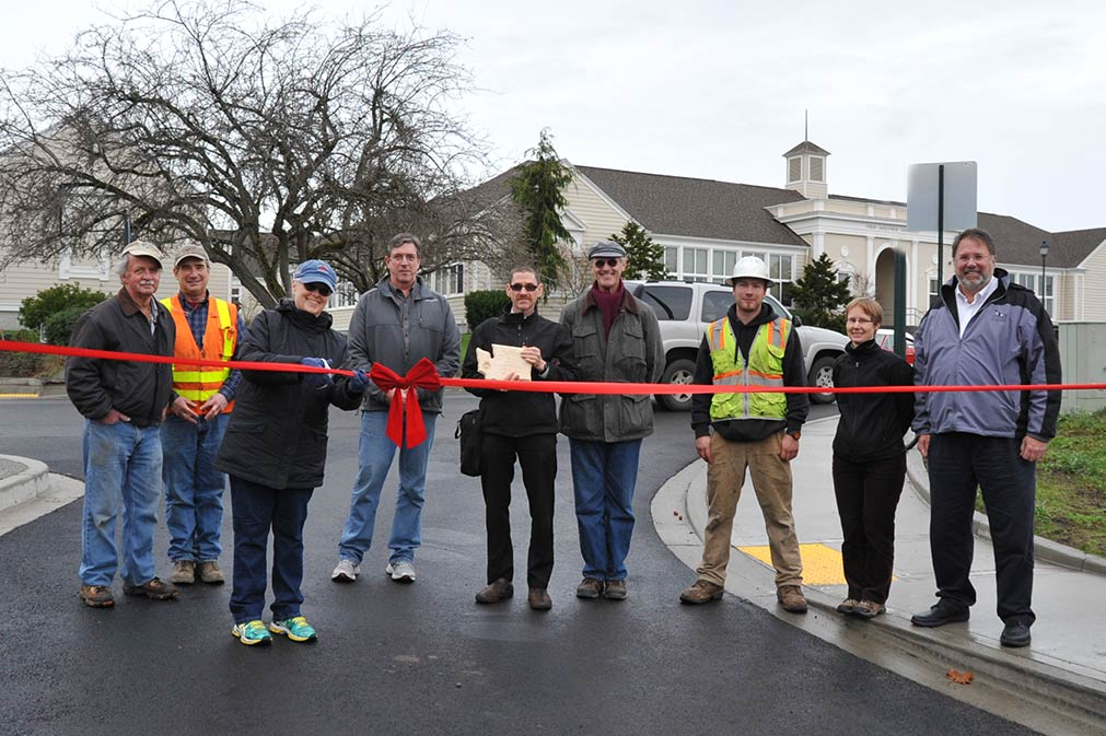 L-R:  Pete Dawson, Tia's Tacos; Project Contractor Mike Carlson, Mike Carlson Enterprises; Mayor Carrie Lacher; Town Councilman Steve Hushebeck; TIB Project Engineer Greg Armstrong; Town Public Works Director Wayne Haefele; Foreman Brandon Baney, Mike Carlson Enterprises; Project Engineer Tamara Nack, Gray & Osborne; Town Administrator Duncan Wilson - Matt Pranger photo