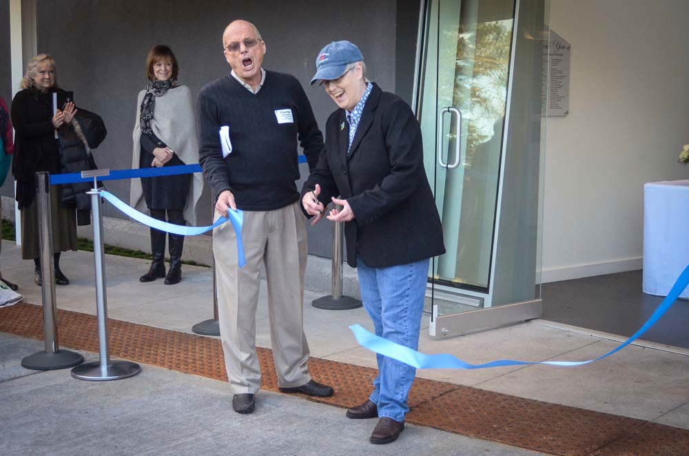 Charlie Bodenstab reacts as Mayor Carrie Lacher cuts the ribbon to mark the grand opening of the Islands Museum of Art - Tim Dustrude
