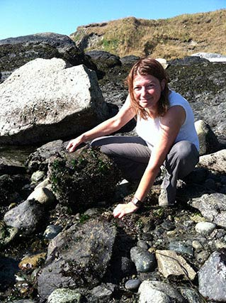 Petra turning rocks to collect Northern Clingfish at Cattle Point Beach - C. Linkem photo