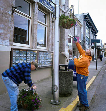 Hanging the flower baskets - Contributed photo