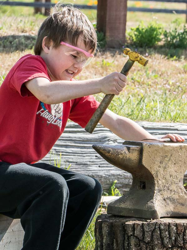 Hammering things at Island Rec's 2015 Children's Festival - Aaron Shepard photo