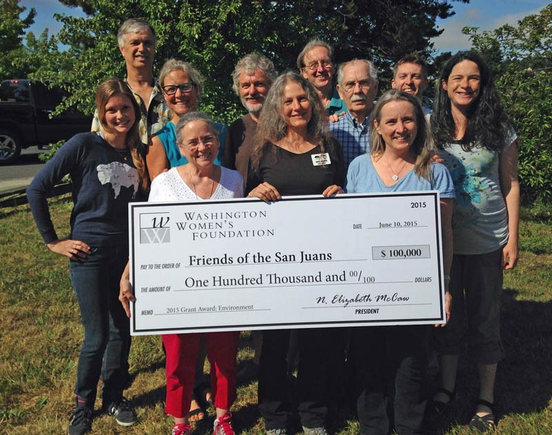 FRIENDS of the San Juans' staff and board proudly accept the $100,000 grant from the Washington Women's Foundation - Contributed photo