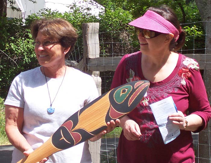 Dianna Down and Sydney Exton with commemorative paddle -PhotobyNancy Way, The Watership Company, West Beach Creek project contractor