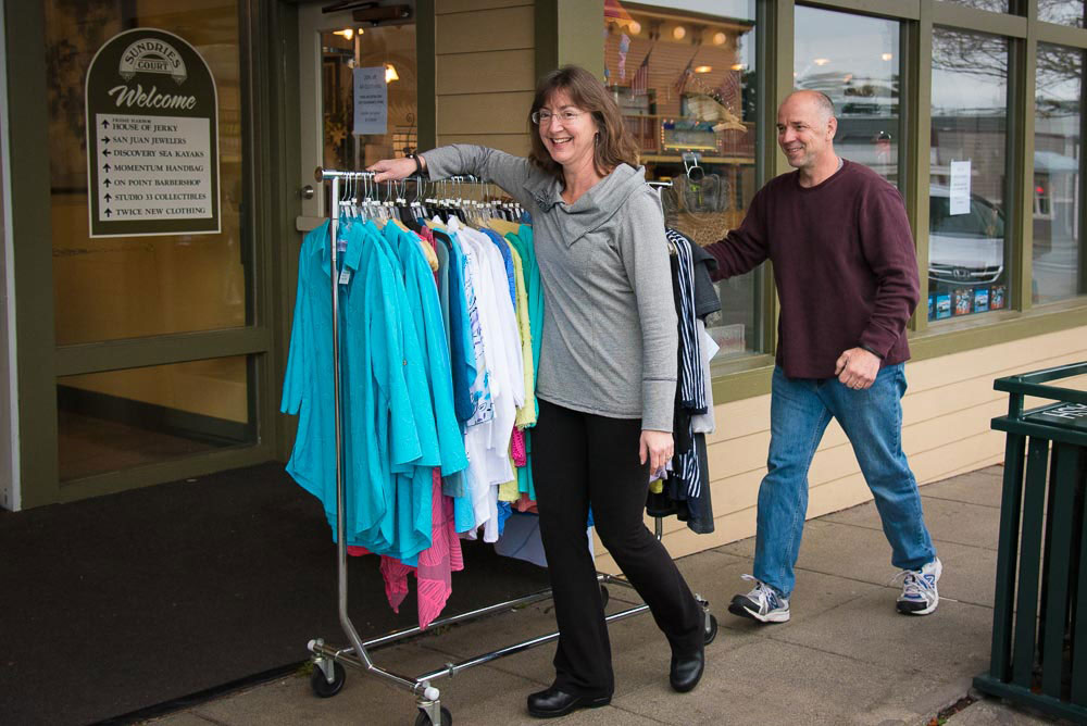 Gail and Randy Schnee moved inventory from their previous location to their new one using their wheeled display racks - Tim Dustrude photo