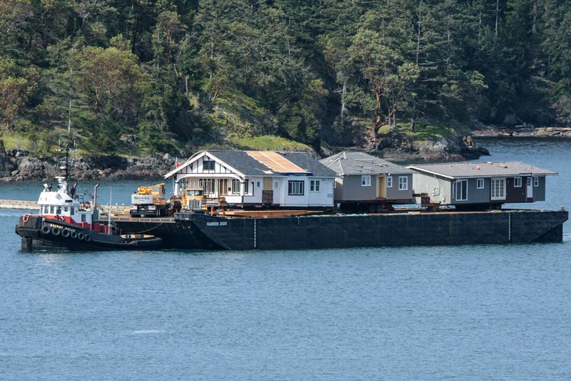 Homes arrive by barge  for the Hometrust - Aaron Shepard photo
