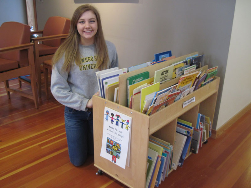 Patricia Deitz and a cart full of books - Contributed photo