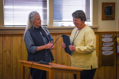 On behalf of the Town of Friday Harbor, Mayor Carrie Lacher gives the official proclamation to organizer Lori Stokes - Tim Dustrude photo