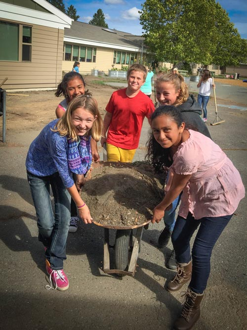 6th graders haul a heavy load for their garden - Contributed photo