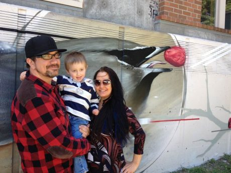 Mural artist Jake Wagoner, his fiancee Jeane Meyersahm, and their son Dylan after the celebration - Louise Dustrude photo