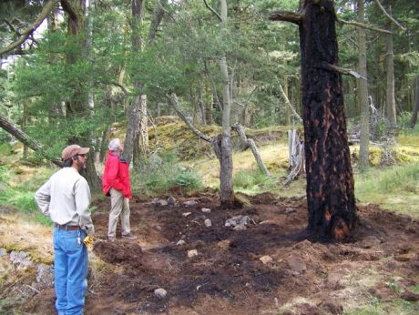 Lopez County Parks Manager David St. George and Parks Commissioner Bill Scherer survey fire damage at Shark Reef - Contributed photo