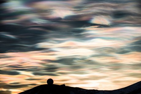 Rarely seen nacreous clouds over McMurdo Station are only visible when the atmosphere is exceptionally cold and the sun is just below the horizon. A once common sight, the increased temperatures and storms are making them a rare phenomenon even in Antarctica - Alasdair Turner photo