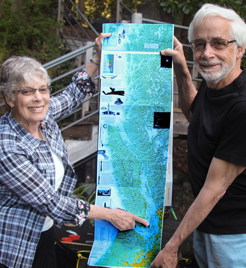 Leslie and Val hold up the map showing how far they'll travel