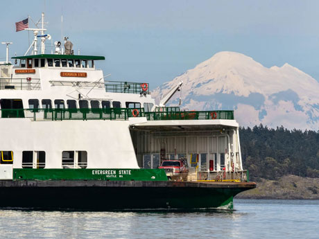 Washington State ferry Evergreen State passes in front of Mount Baker and Shaw Island on May 4, 2011, while entering Friday Harbor in the San Juan Islands - Aaron Shepard photo