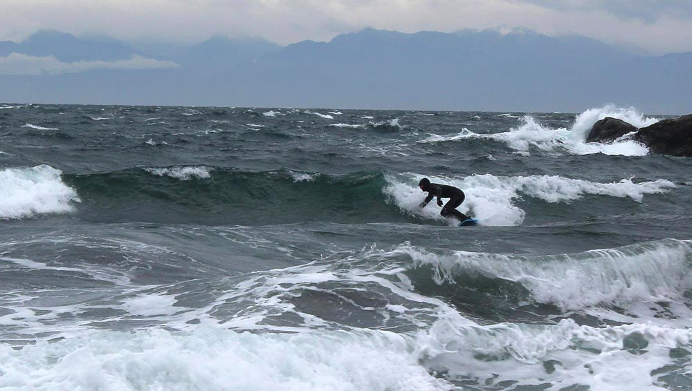 Local Liam Corey takes the waves at Eagle Cove, last Sunday - Photo credit:  Dan Burton